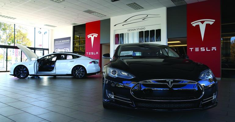 Tesla bucks the traditional dealership franchise system by operating its own showrooms