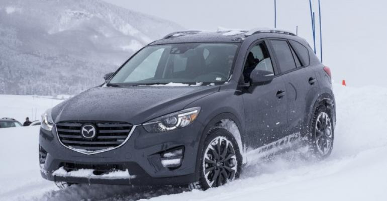 Driving CX5s in snow shows off AWD system