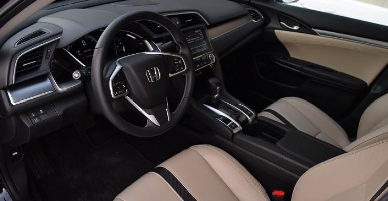 rsquo16 Honda Civic Touring has attractive beigeandblack theme bronze metal accents