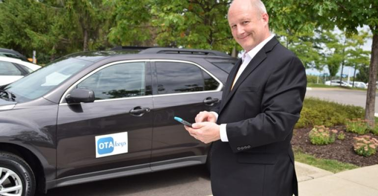 Contirsquos Don Finney demonstrates how OTA Key works with demo vehicle