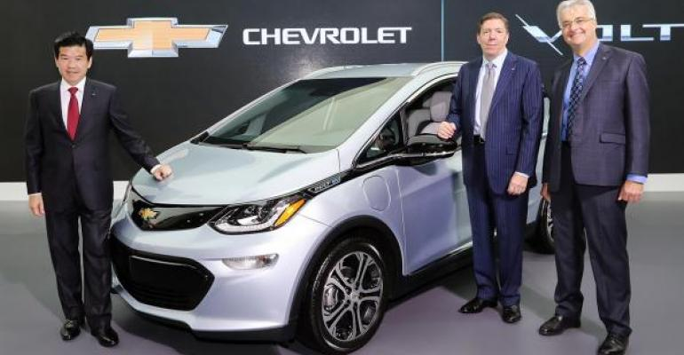 Left to right GM Korea President and CEO Kim GM International vice presidentplanning and program management Paddock and GM deputy directorelectrification engineering Murray show off Chevrolet Bolt EV at Korea Electronics Show