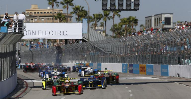Formula 1 EVs jockey for position at 2015 race in Long Beach CA