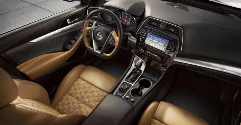 Faceted aluminum trim premium leather and Alcantara help Maxima interior punch above its weight