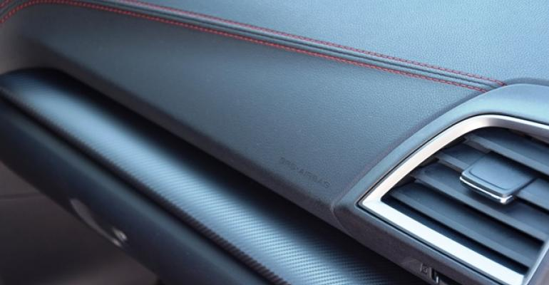 Angular shapes red stitching faux carbon fiber key design features of Impreza