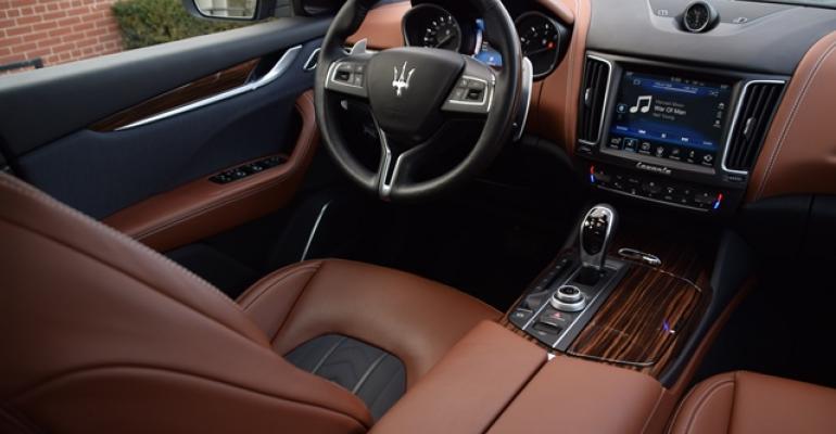 Crowning touch Maserati logo on steering wheel