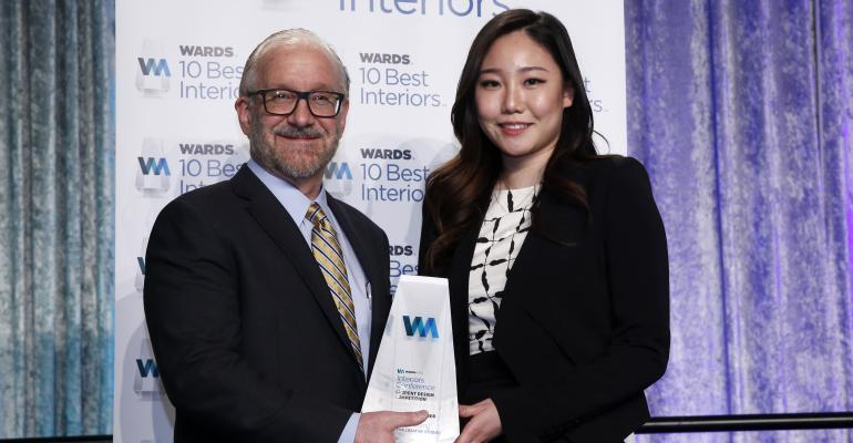 Senior Content Director Drew Winter awards CCS student Eileen Hwang WardsAuto grand prize trophy for beautifully rendered fullsize Volvo SUV concept that converts into mobile office
