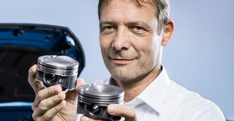 Like Otto Atkinson and Miller VW engineer Ralf Budack optimizes combustion Crowned piston at left enables ldquoBcyclerdquo