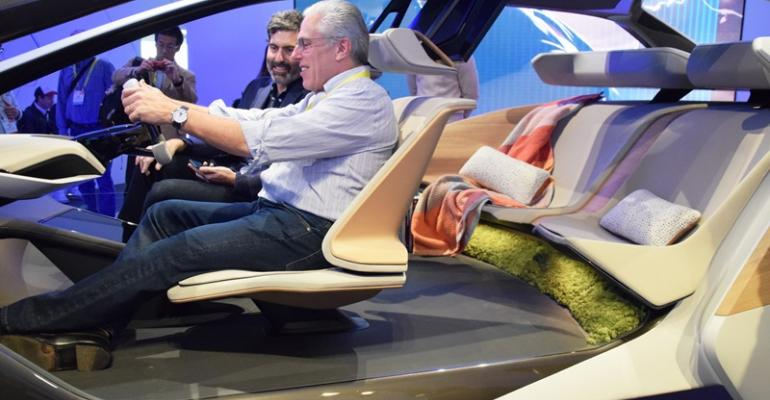 BMWrsquos Eric Brown in passenger seat demonstrates holographic controls in i Inside Future Sculpture at CES in January