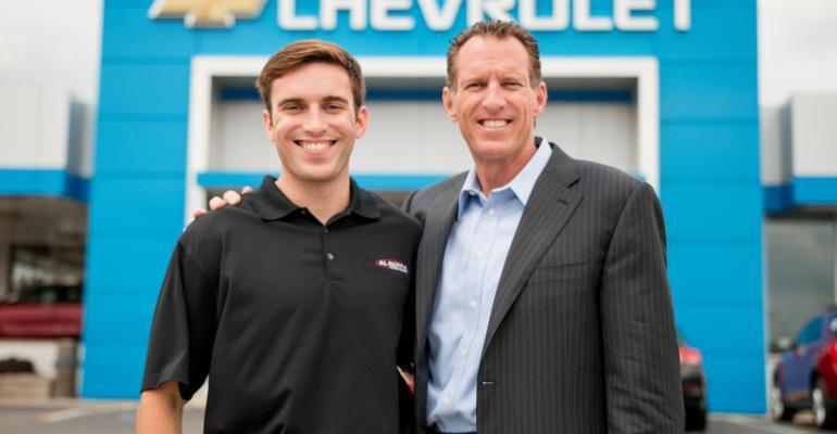 Joe Serra and son Matt at Al Serra Auto Plaza which set record last year
