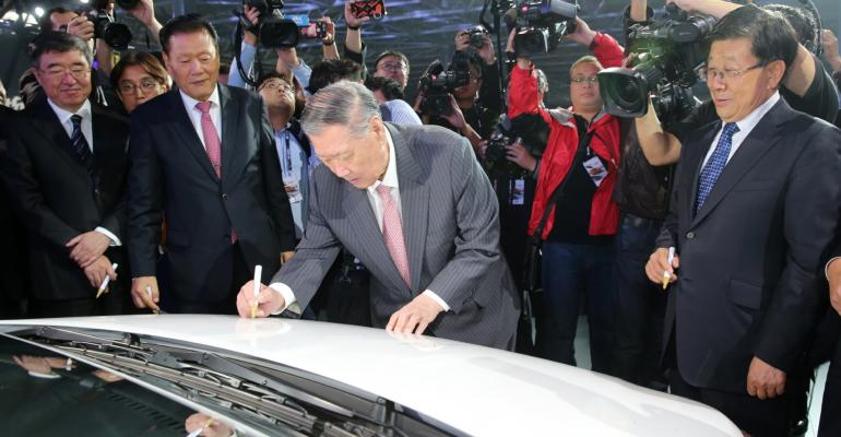 Hyundai CEO Chung signs Job 1 at opening of Cangzhou China plant in November 2016