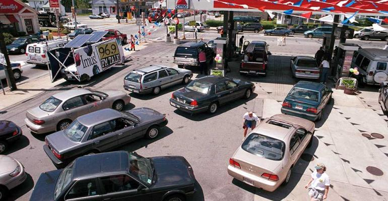 Cars line up at pumps on Memorial Day 2000 Lines like these and those seen in 1970s might recur at future EV charging stations