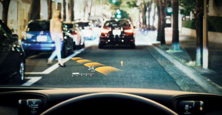 HUD indicates speed presence of pedestrian near car