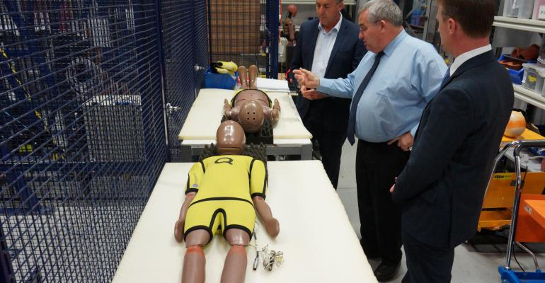 left to right Transport Minister Chester Crash Lab General Manager Dal Nevo and ANCAP CEO Goodwin examine new test dummies