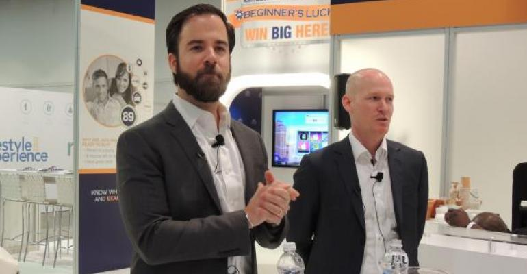 Schnabl left and Gnauck discuss new software product conquestMastermind at the 2018 NADA Convention and Exposition in Las Vegas
