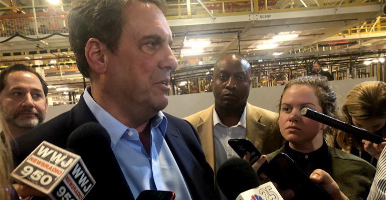 Reuss speaks with reporters after Chevy Silverado HD reveal in Flint.