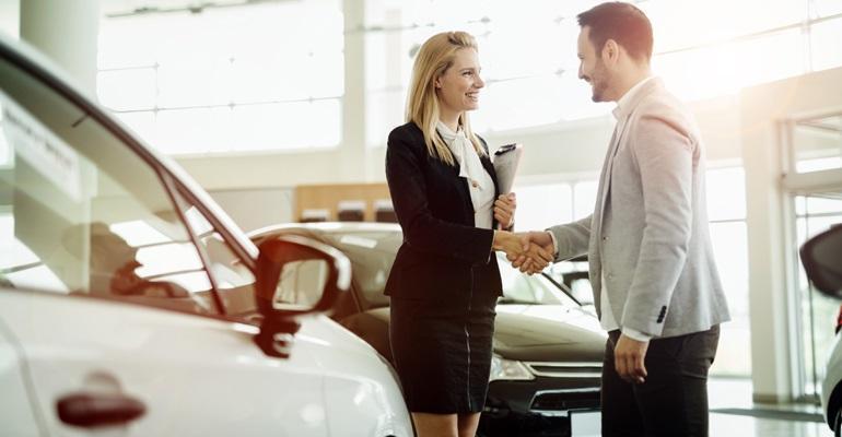 Dealership saleswoman customer