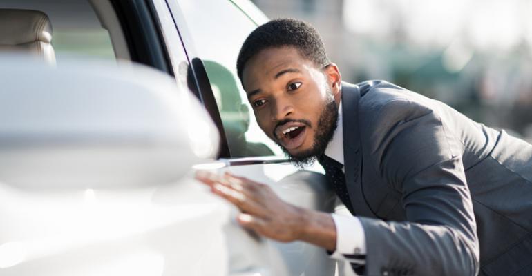 young man admires car.jpg