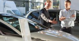 Dealer-Salesman with customer (Adobe Stock).jpeg
