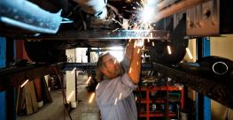 Mechanic with catalytic converter  (Getty).jpg