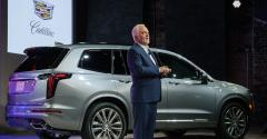 Brand chief Carlisle with Cadillac XT6 in Detroit.