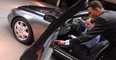 Dealer-car salesman with customer (Getty).jpg