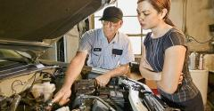 auto tech with young customer.jpg