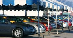 car dealership tent and cars.jpg