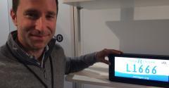 Gensler with digital license plate at Reviverrsquos Detroit auto show exhibit