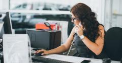woman at desk on phone.jpg
