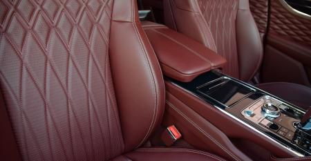 Bentley Flying Spur  console and seat stitch pass side.JPG