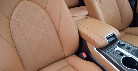 Toyota Highlander perforated seats and armrest.JPG