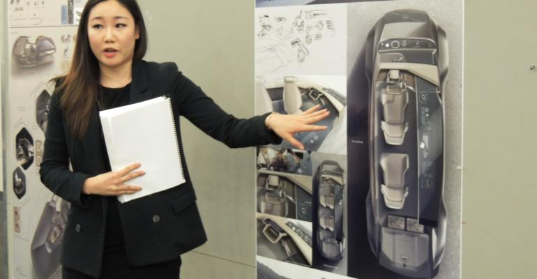 Grand Award winner Eileen Hwang presenting her project to judges during final review