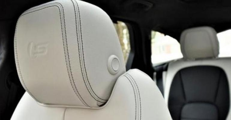 Sbranded head restraints with contrast stitching