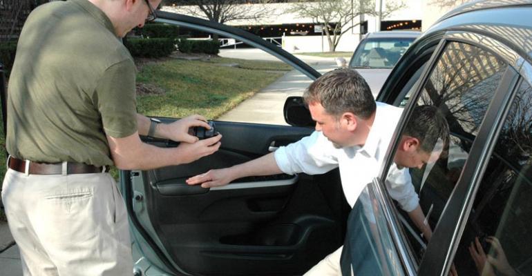 Associate Editor Byron Pope reviews Honda CRV door trim during video shoot