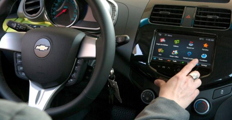Auto makers responding to consumer demand adding leather seats navigation systems and infotainment display to smallcar interiors