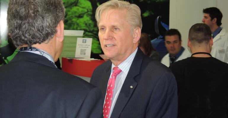 Denso Senior Vice President Terry Helgesen speaks at Detroit auto show press conference