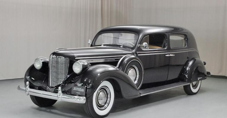 Staggered work system used to build vehicle bodies like this 1938 Chrysler Custom Imperial comes to an end and Briggs Manufacturing Co