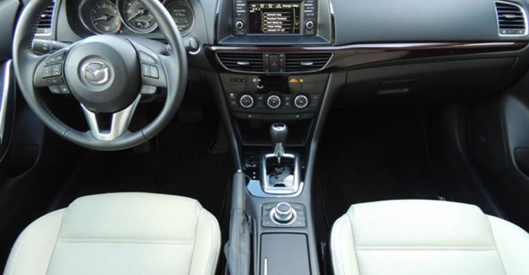 Whitealmond seats burgundyhued instrumentpanel trim add luxury touch to rsquo14 Mazda6
