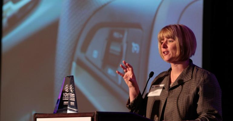 GMrsquos Kathy Sirvio accepts Wardrsquos 10 Best Interiors trophy at last yearrsquos conference for Chevy Sonic and this year will accept for Chevy Spark