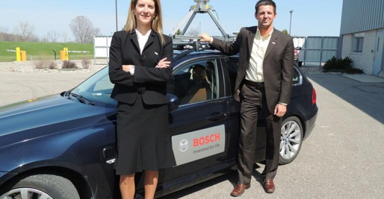 Bosch39s MariaBelen Aranda Colas left and Kay Stepper demonstrate highly automated concept car at Flat Rock MI test track