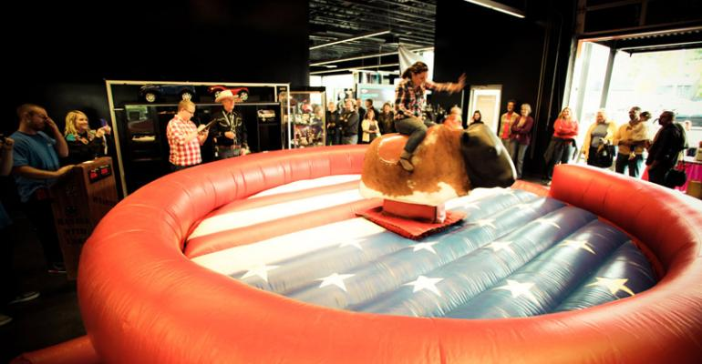 Mechanical bull riding at dealership