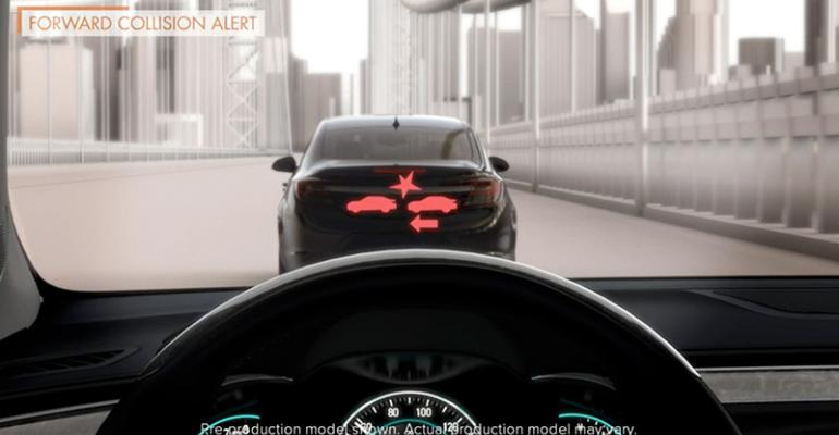 The rsquo14 Buick LaCrosse with Forward Collision Alert cautions of a slowmoving vehicle ahead