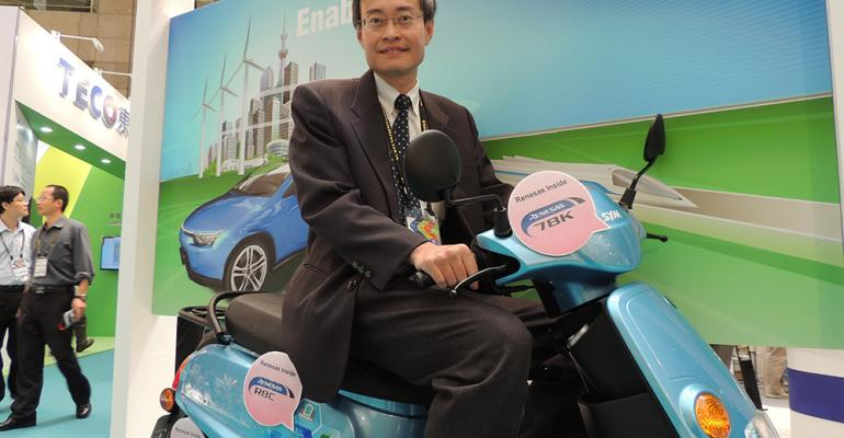 Eric Wang ready to roll on Sym eWoo electric scooter which uses three Renesas microprocessors