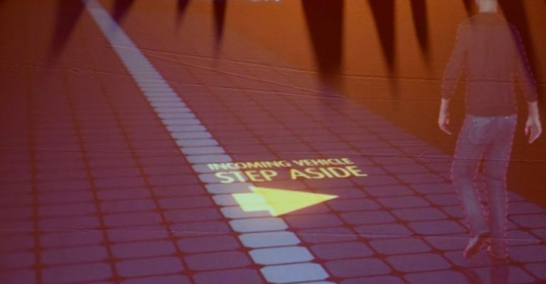 Slide at Valeo press conference illustrates how light projection can be used to warn pedestrians