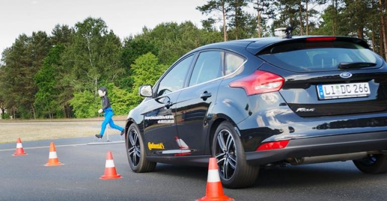 Ford Focus with automatic emergency braking easily avoids hitting child dummy