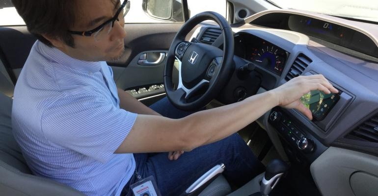 Shinichi ldquoMaxrdquo Akama Principal EngineerHonda Silicon Valley Lab activates a prototype infotainment system that uses a smartphone as a carrsquos database