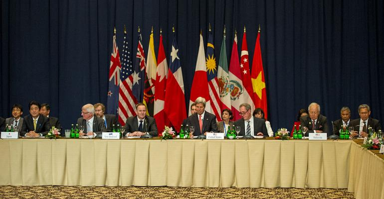 US Secretary of State John Kerry center participates in 2013 TPP meeting