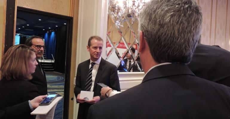 Diess talks to reporters after addressing VW dealers at closeddoor meeting