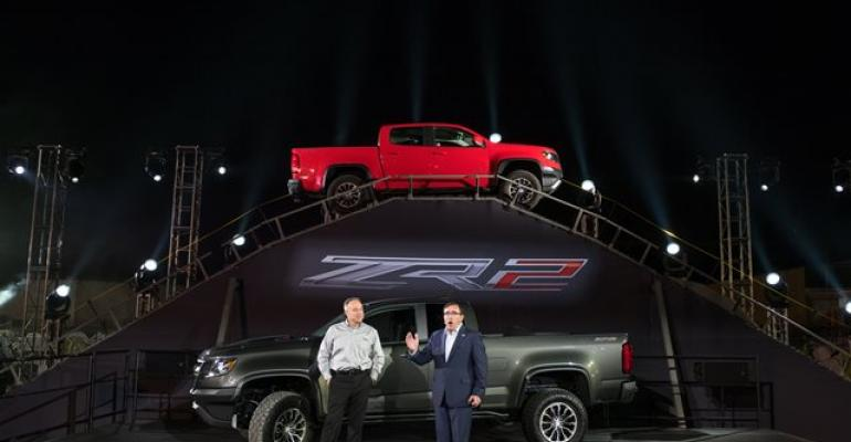 GM North America President Alan Batey right Chevy Performance Executive Mark Dickens with Colorado ZR2 offroader in Los Angeles