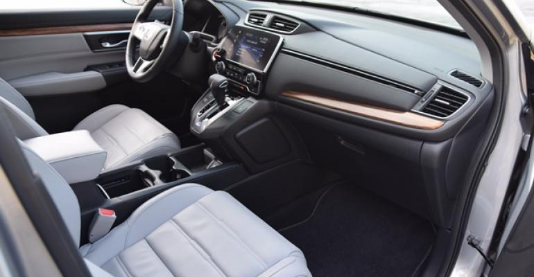 Snowwhite leather faux wood accents among luxurylike touches in winning CRV